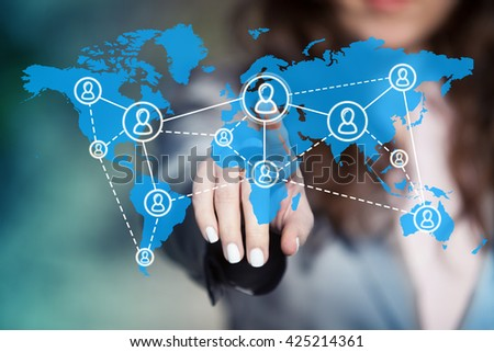 Businesswoman connecting worldwide social network scheme on virtual touch screen.  - stock photo