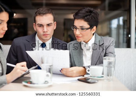 businesswoman consulting a partner - stock photo