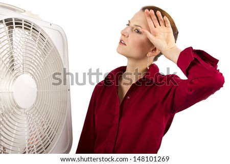 Businesswoman cooling off with a fan  - stock photo