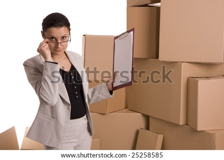 businesswoman correcting glasses keeping clipboard, on carton boxes background - stock photo