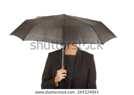 Businesswoman covering her head with umbrella. - stock photo