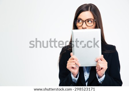Businesswoman covering her mouth with tablet computer and looking away isolated on a white background - stock photo