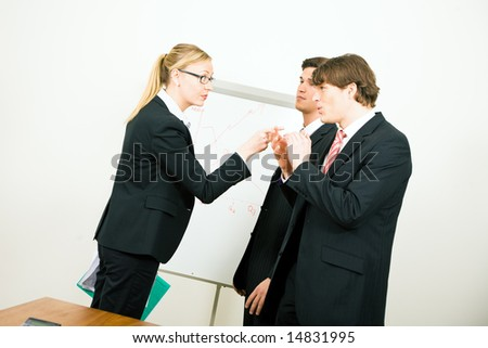 Businesswoman criticizing her colleague - stock photo