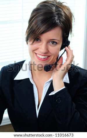Businesswoman Customer Service Agent Wearing A Telephone Headset