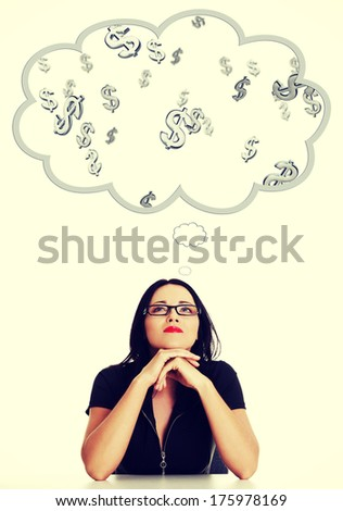 Businesswoman daydreaming about earnig lot of money (dollars) - stock photo