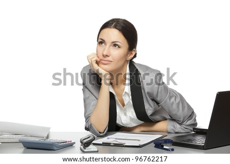 Businesswoman daydreaming at her work place, over white background