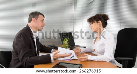 Businesswoman discussing with male colleague - stock photo
