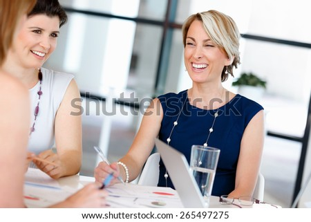 Businesswoman doing a presentaion in front of her collegues - stock photo