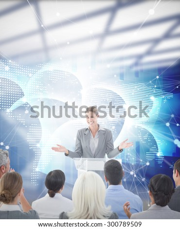 Businesswoman doing speech during meeting against global business graphic in blue - stock photo