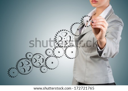 businesswoman drawing a sketch of the mechanism, create a successful business concept - stock photo