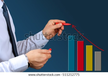 Businesswoman  drawing a virtual  graph by  a red pen