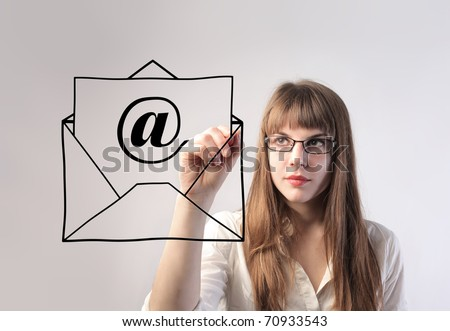 Businesswoman drawing an e-mail envelope - stock photo