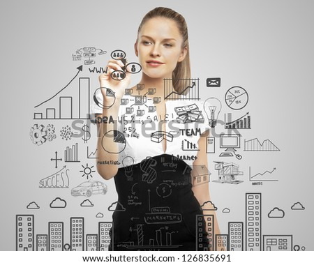 businesswoman drawing business plan concept - stock photo