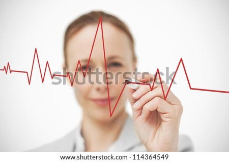 Businesswoman drawing ECG line in red