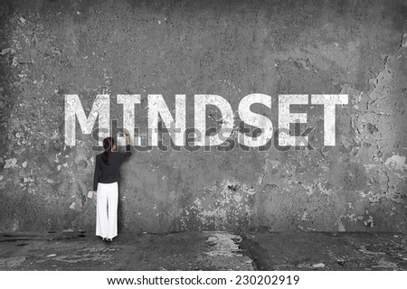 businesswoman drawing mindset on the wall