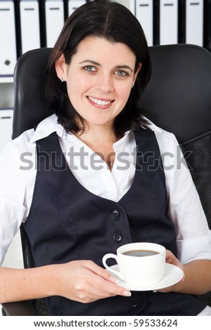 businesswoman drink coffee in office - stock photo