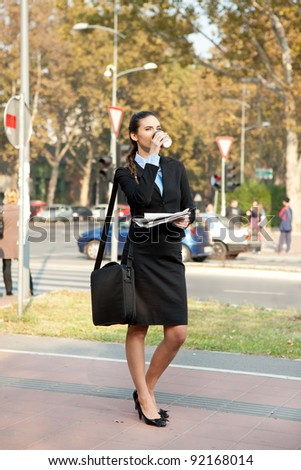 businesswoman drinking cafe on street, the way to work - stock photo