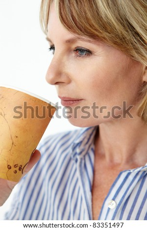 Businesswoman drinking takeout coffee - stock photo