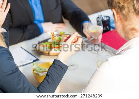 Businesswoman eating salad on brunch in office - stock photo