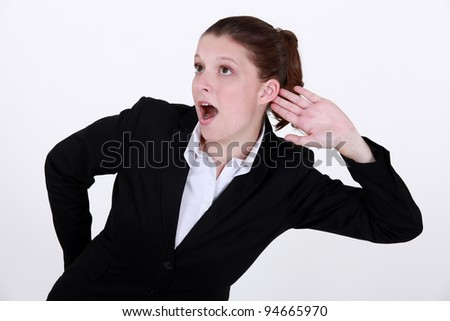 Businesswoman exaggerating listening - stock photo