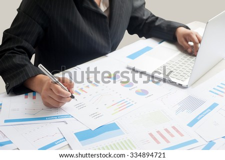 Businesswoman examine finance, tax, accounting, statistics and analytic research concept
