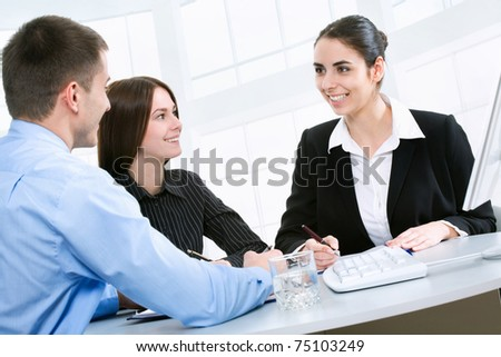 Businesswoman explaining a new project to colleagues - stock photo