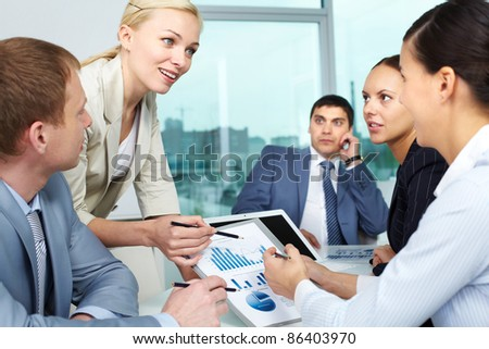 Businesswoman explaining business plan to her colleagues