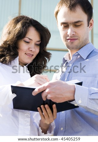 Businesswoman explains the corporate ideas to man - stock photo