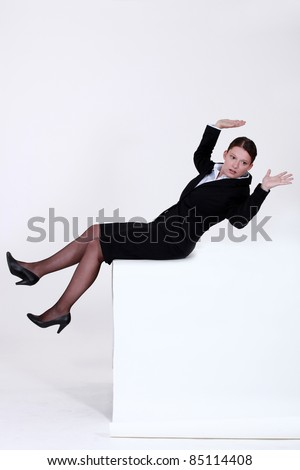 Businesswoman falling backwards - stock photo