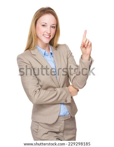 Businesswoman finger point up - stock photo