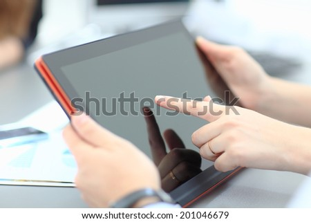Businesswoman finger pointing to tablet-pc - stock photo