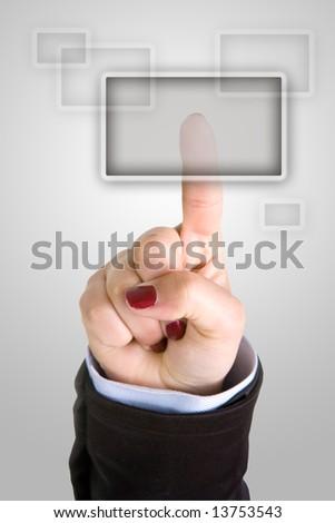 businesswoman finger pushing button - stock photo