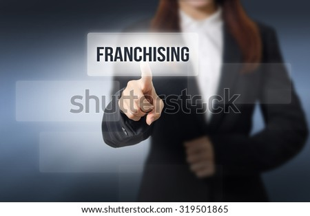 Businesswoman, Focus on hand pointing FRANCHISING word on virtual screen  - stock photo
