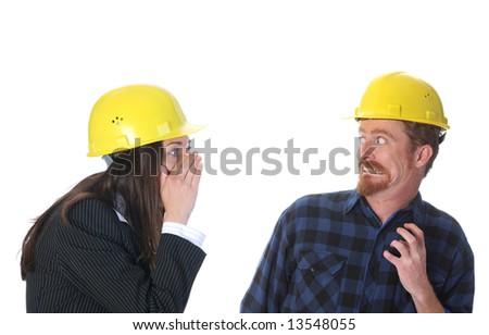 businesswoman gestures telling something to afraid construction worker on workplace