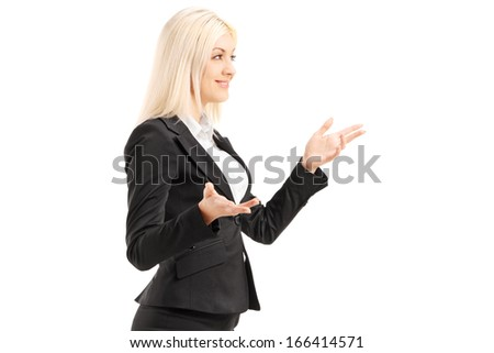 Businesswoman gesturing with hands, standing in  profile, isolated on white background - stock photo