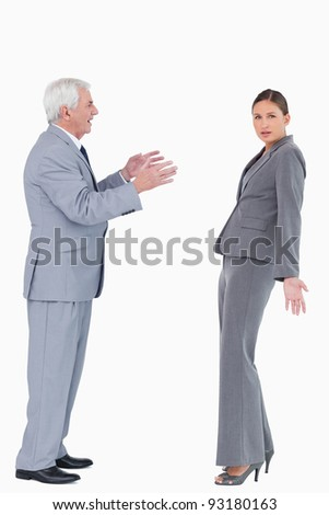 Businesswoman getting accused by colleague against a white background - stock photo