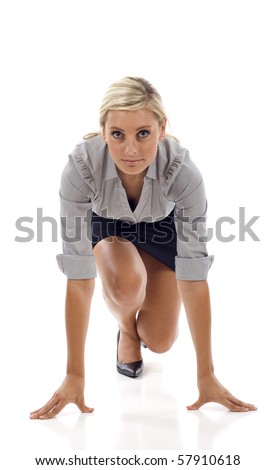 Businesswoman getting ready for race isolated over white - stock photo