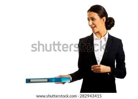 Businesswoman giving a binder to someone. - stock photo