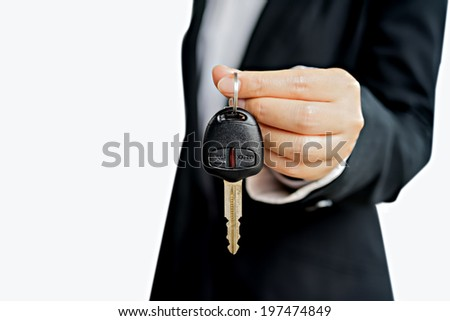 BusinessWoman giving a car key - stock photo