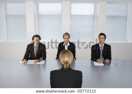 Businesswoman Giving Presentation to Executive Team - stock photo