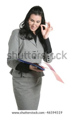Businesswoman glasses teacher positive expression looking folders - stock photo