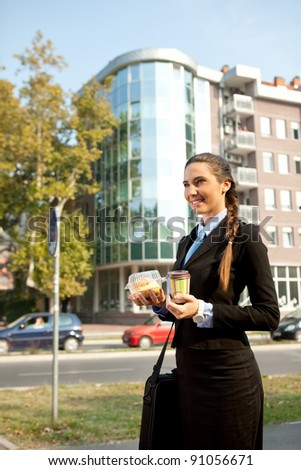 businesswoman  going on work with breakfast in  hands - stock photo
