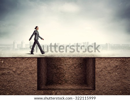 Businesswoman going to the trap - stock photo