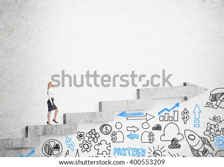 Businesswoman going up stairs shaped by concrete arrow, business icons under it. Concrete background. Concept of career growth. - stock photo