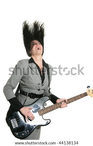 Businesswoman guitar player suit and rock and roll - stock photo