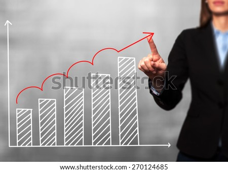 Businesswoman hand drawing growth graph on visual screen. Isolated on grey. Women finger on graph.  Business, internet, technology concept. Stock Image