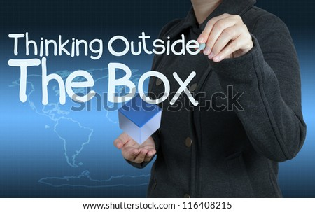 businesswoman hand draws word thinking outside the box as concept - stock photo