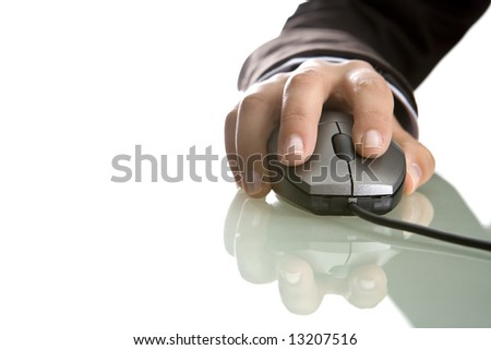 businesswoman hand on computer mouse - stock photo