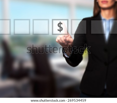 Businesswoman hand press dollar icon button on visual screen. Women finger on dollar icon. Isolated on office. Business, technology, internet concept. Stock Image - stock photo