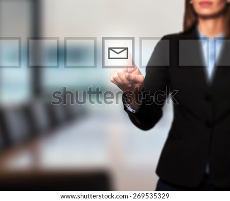 Businesswoman hand press mail icon button on visual screen. Women finger on mail icon. Isolated on office. Business, technology, internet concept. Stock Image - stock photo
